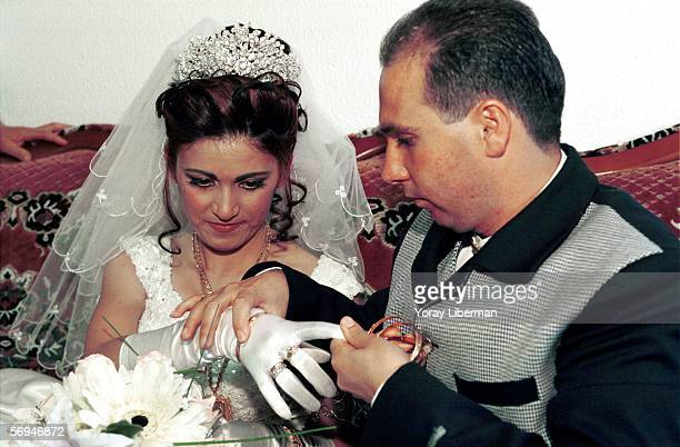 MAS'ADAH ISRAEL DECEMBER 16 Hamed following the Druz tradition gives his future wife Ruida gold jewelry at home after arriving from the Qunetra...