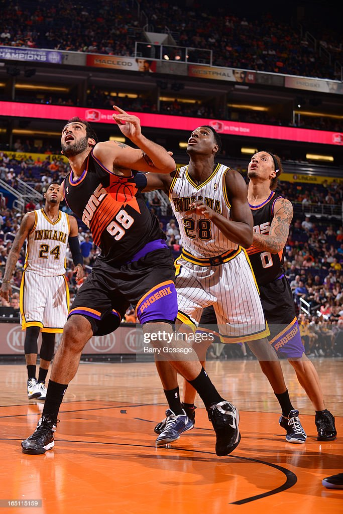 Hamed Haddadi #98 and Michael Beasley #0 of the Phoenix Suns battle for position with Ian Mahinmi #28 of the Indiana Pacers on March 30, 2013 at U.S. Airways Center in Phoenix, Arizona.