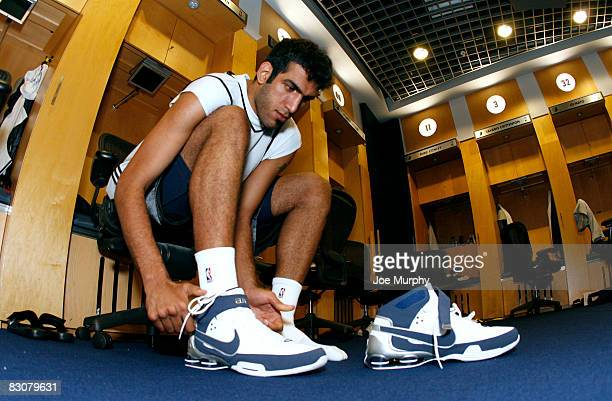 Hamed Haddadi of the Memphis Grizzlies laces up his sneakers before practice during the Memphis Grizzlies Training Camp on October 1 2008 at the...