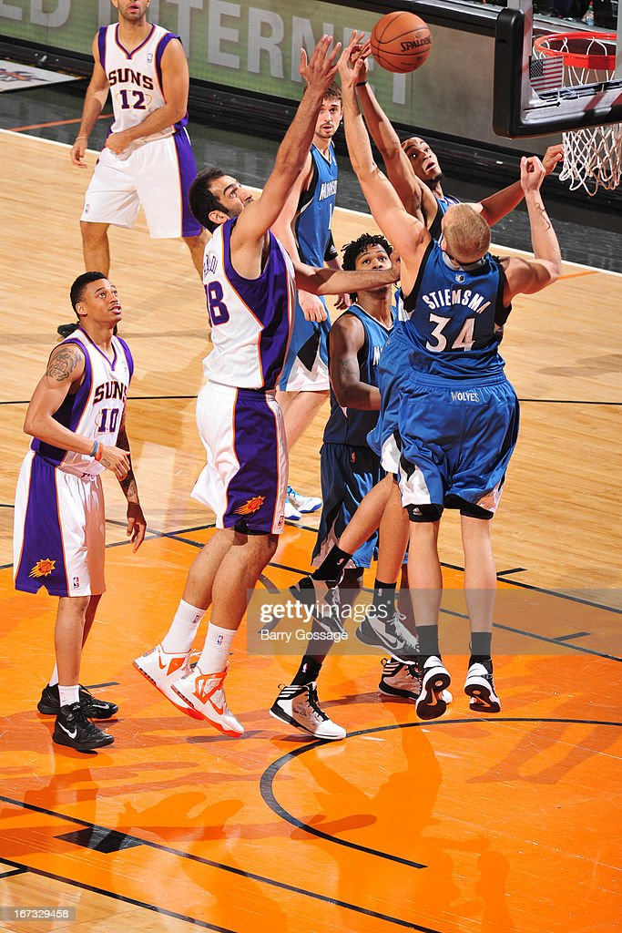 Hamed Haddadi #98 of the Phoenix Suns and Greg Stiemsma #34 of the Minnesota Timberwolves go up for a rebound on March 22, 2013 at U.S. Airways Center in Phoenix, Arizona.