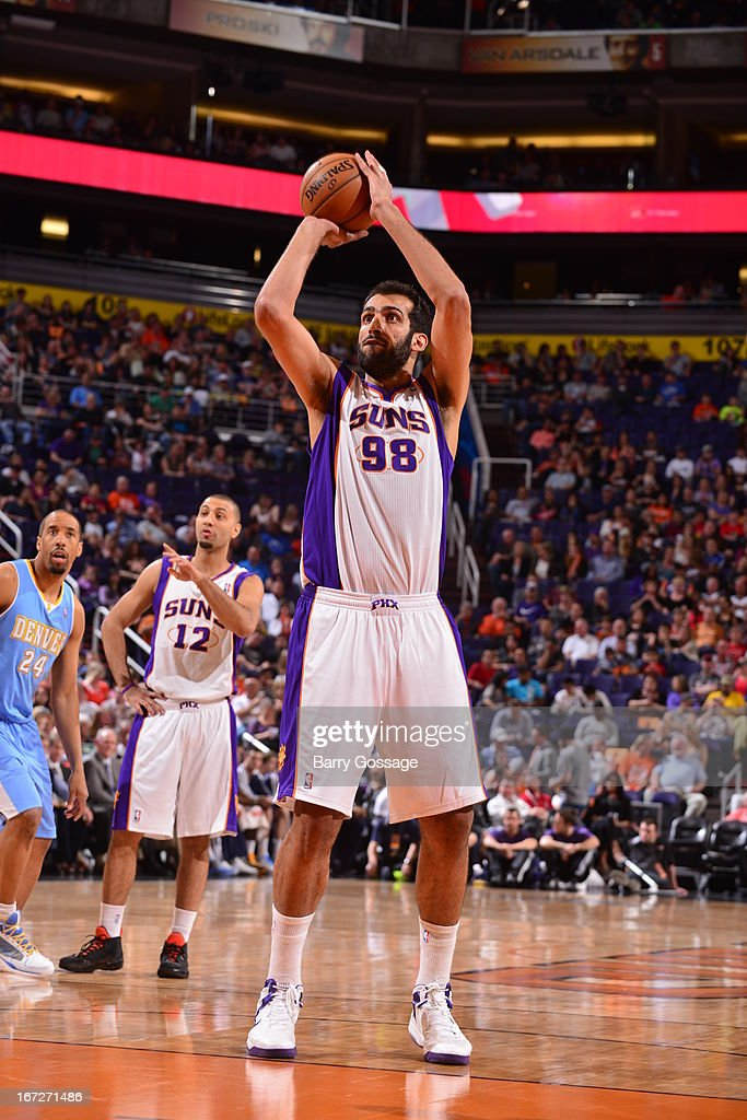 <a gi-track='captionPersonalityLinkClicked' href=/galleries/search?phrase=Hamed+Haddadi&family=editorial&specificpeople=5544688 ng-click='$event.stopPropagation()'>Hamed Haddadi</a> #98 of the Phoenix Suns attempts a foul shot against the Denver Nuggets on March 11, 2013 at U.S. Airways Center in Phoenix, Arizona.