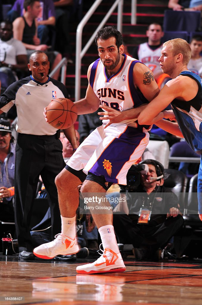 Hamed Haddadi #98 of the Phoenix Suns drives against Greg Stiemsma #34 of the Minnesota Timberwolves on March 22, 2013 at U.S. Airways Center in Phoenix, Arizona.