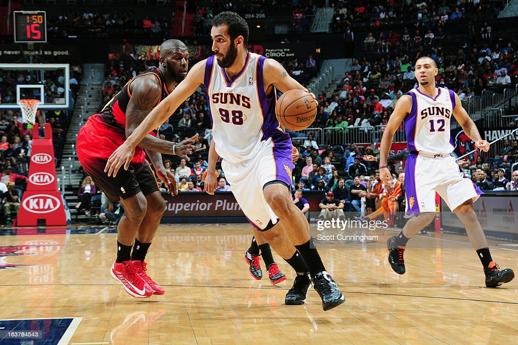 <a gi-track='captionPersonalityLinkClicked' href=/galleries/search?phrase=Hamed+Haddadi&family=editorial&specificpeople=5544688 ng-click='$event.stopPropagation()'>Hamed Haddadi</a> #98 of the Phoenix Suns drives to the hoop against the Atlanta Hawks on March 15, 2013 at Philips Arena in Atlanta, Georgia.
