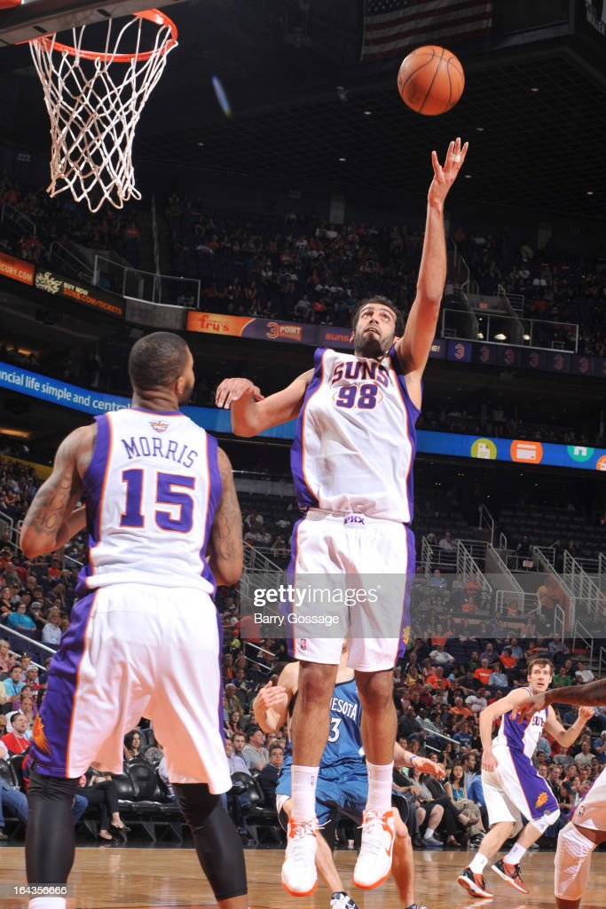 Hamed Haddadi #98 of the Phoenix Suns grabs a rebound against the Minnesota Timberwolves on March 22, 2013 at U.S. Airways Center in Phoenix, Arizona.