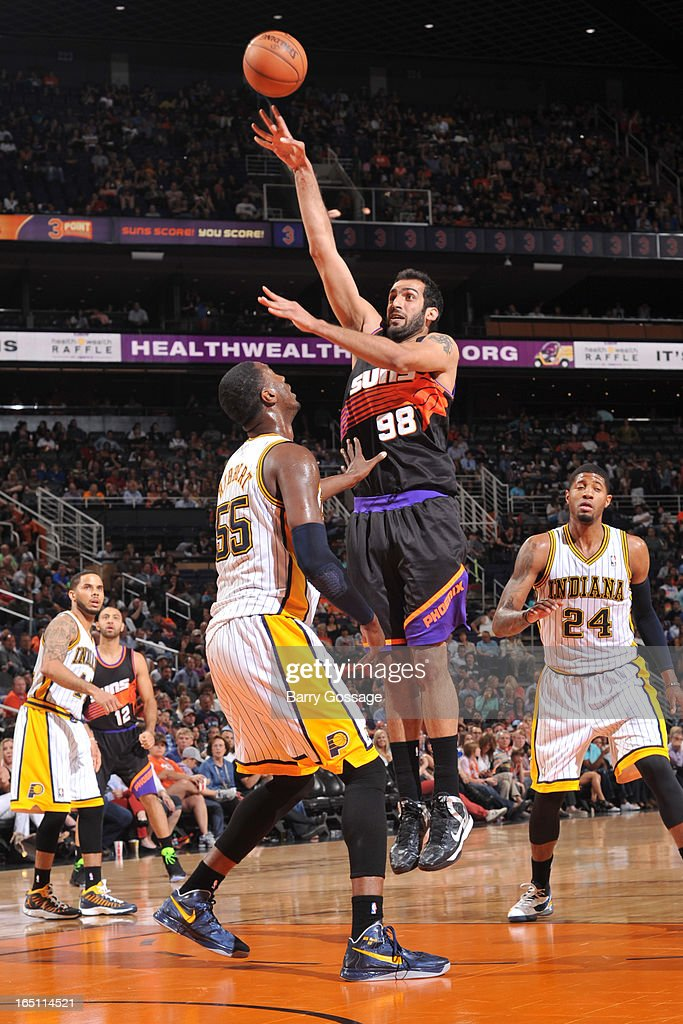 Hamed Haddadi #98 of the Phoenix Suns shoos over Roy Hibbert #55 of the Indiana Pacers on March 30, 2013 at U.S. Airways Center in Phoenix, Arizona.