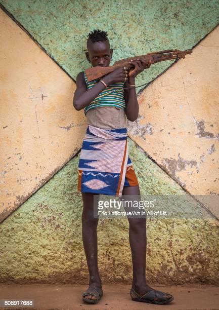 Hamer tribe boy with a wooden kalshnikov Omo valley Dimeka Ethiopia on June 10 2017 in Dimeka Ethiopia