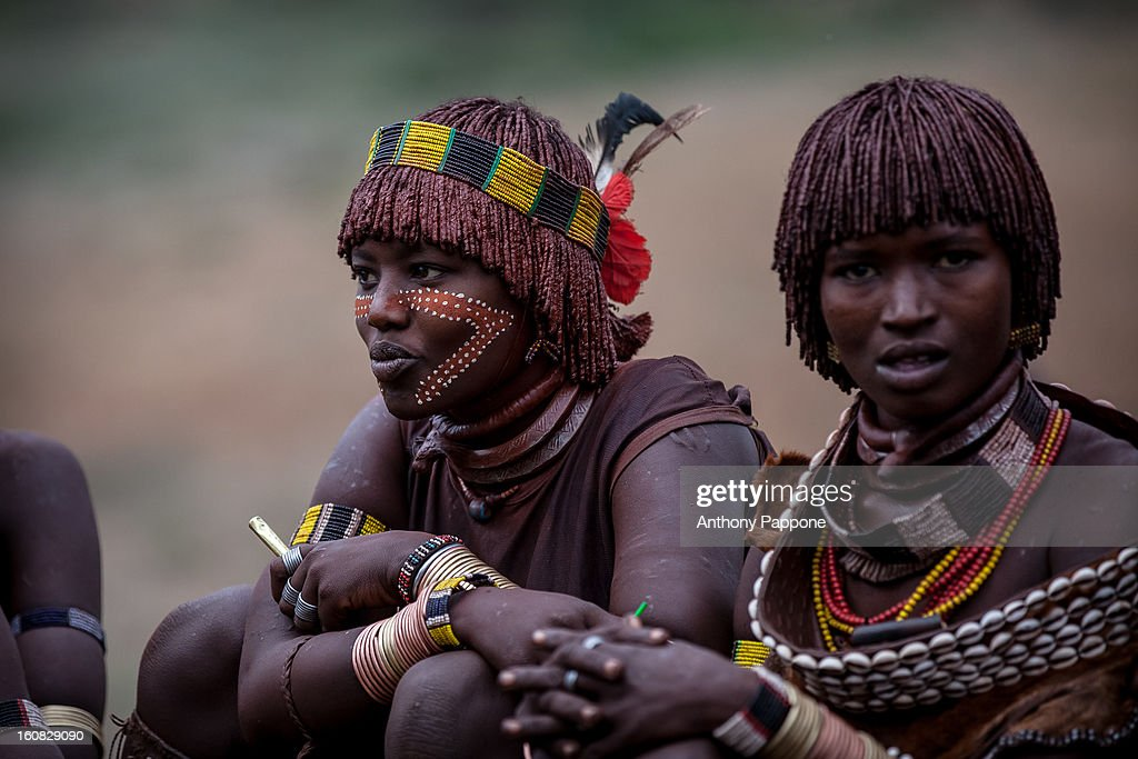 CONTENT] hamer tribe paint their faces during the ceremony bull jumping. Bull jumping ceremony is a rite of passage ceremony for men coming of age must be done before a boy is permitted to marry. The boy must jump the cows four times to be successful. This test is performed while naked except for a few cords bound across the chest as a symbol of the childhood he is about to leave behind him. On completion of this test, the young man joins the others boys who have recently passed the same test and who spend the next few months of their lives supervising these events in villages throughout the Hamar territory. The ceremonies end with several days of feasting, including the typical jumping dances, accompanied by as much sorghum beer as the bull-jumper's family can provide to the visitor.