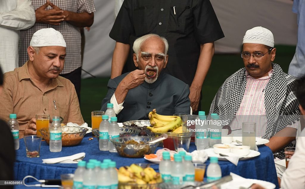 Hamid Ansari, Vice President of India, Delhi Chief Minister Arvind Kejriwal and Deputy Chief Minister of Delhi Manish Sisodia during the Iftar party Hosted by Arvind Kejriwal, on June 30, 2016 in New Delhi, India. In the ninth month of the Islamic calendar, Muslims worldwide observe Ramadan, a period of fasting and other rituals designed to bring self-purification through self restraint and other good deeds. The fasting begins at dawn and lasts until sunset, when observers break their fast with an evening meal called the Iftar.