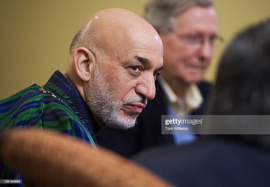Hamid Karzai, President of Afghanistan, poses for a photo before a meeting in the Capitol with with Senate Minority Leader Mitch McConnell, R-K.Y., right, Sen. Bob Casey, D-Pa., Sen. Deb Fischer, R-Neb., and Sen. Tim Kaine, D-Va.