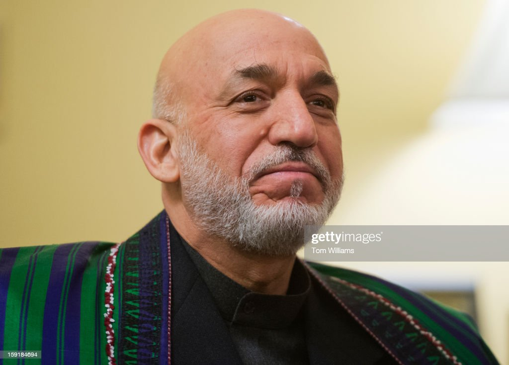 Hamid Karzai, President of Afghanistan, poses for a photo before a meeting in the Capitol with with Senate Minority Leader Mitch McConnell, R-K.Y., Sen. Bob Casey, D-Pa., Sen. Deb Fischer, R-Neb., and Sen. Tim Kaine, D-Va.