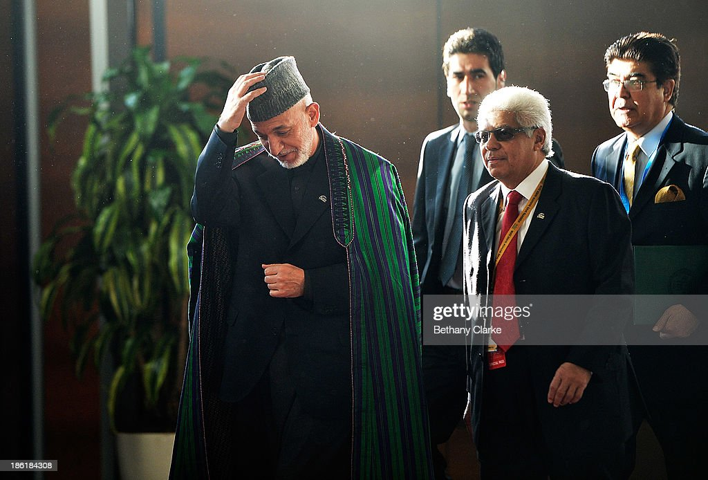 E Hamid Karzai President of the Islamic Republic of Afghanistan arrives at the 9th World Islamic Economic Forum at ExCel on October 29 2013 in London...