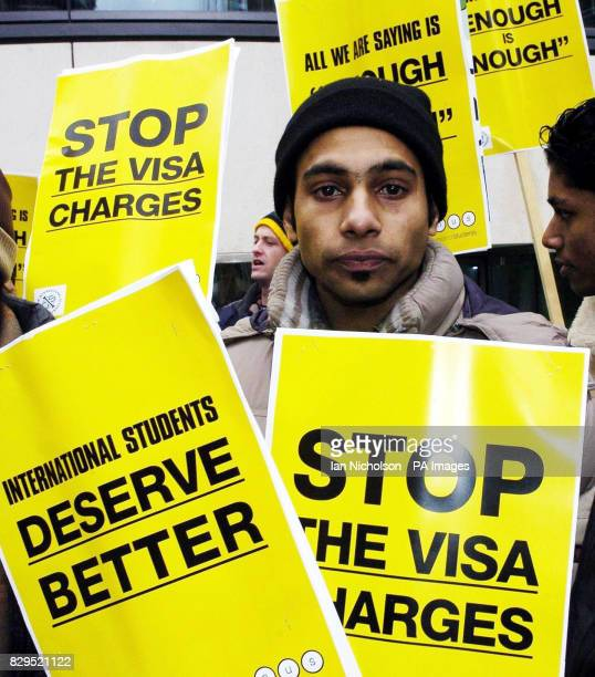 Hamid Nizami from Pakistan joins a protest by students to demonstrate against increased visa charges