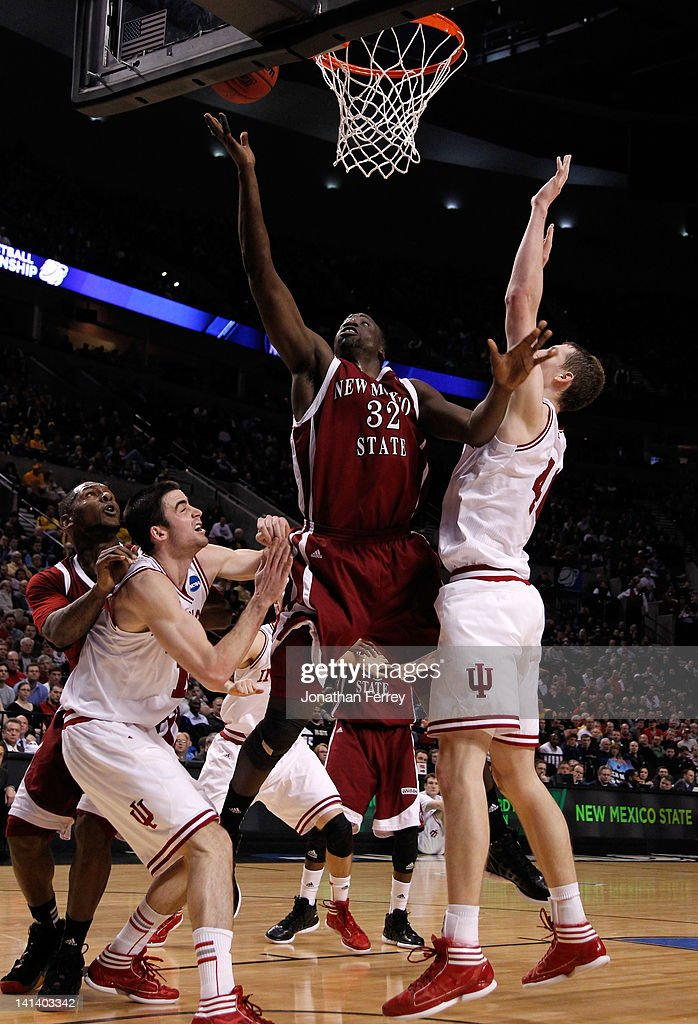 Hamidu Rahman #32 of the New Mexico State Aggies goes up for a shot against Cody Zeller #40 of the Indiana Hoosiers in the first half in the second round of the 2012 NCAA men's basketball tournament at Rose Garden Arena on March 15, 2012 in Portland, Oregon.