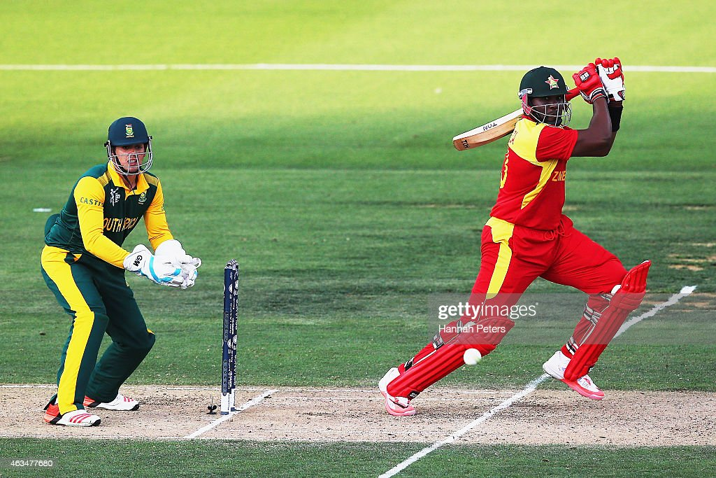 Hamilton Masakadza of Zimbabwe works the ball away for four runs during the 2015 ICC Cricket World Cup match between South Africa and Zimbabwe at...