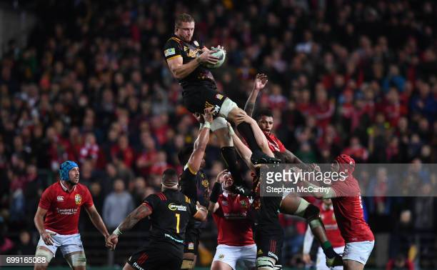 Hamilton New Zealand 20 June 2017 Dominic Bird of the Chiefs takes possession in a lineout ahead of Courtney Lawes of the British Irish Lions during...