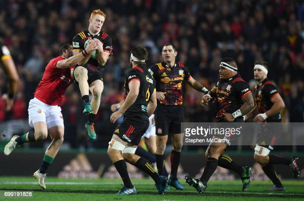 Hamilton New Zealand 20 June 2017 Finlay Christie of the Chiefs is tackled by Robbie Henshaw of the British Irish Lions during the match between the...