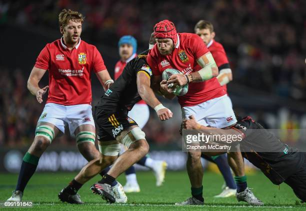 Hamilton New Zealand 20 June 2017 James Haskell of the British Irish Lions is tackled by Lachlan Boshier left and Liam Polwart of the Chiefs during...