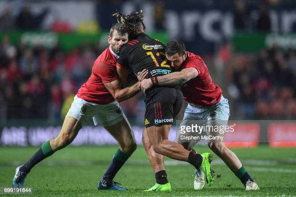Hamilton New Zealand 20 June 2017 Johnny Faauli of the Chiefs is tackled by Jared Payne left and Robbie Henshaw of the British and Irish Lions during...