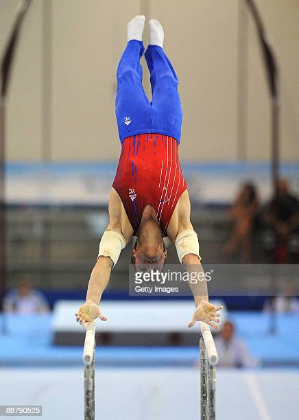 Hamilton Sabot of France competes on the parallel bars during men's Individual AllAround Final on July 1 2009 in Silvi Marina Italy