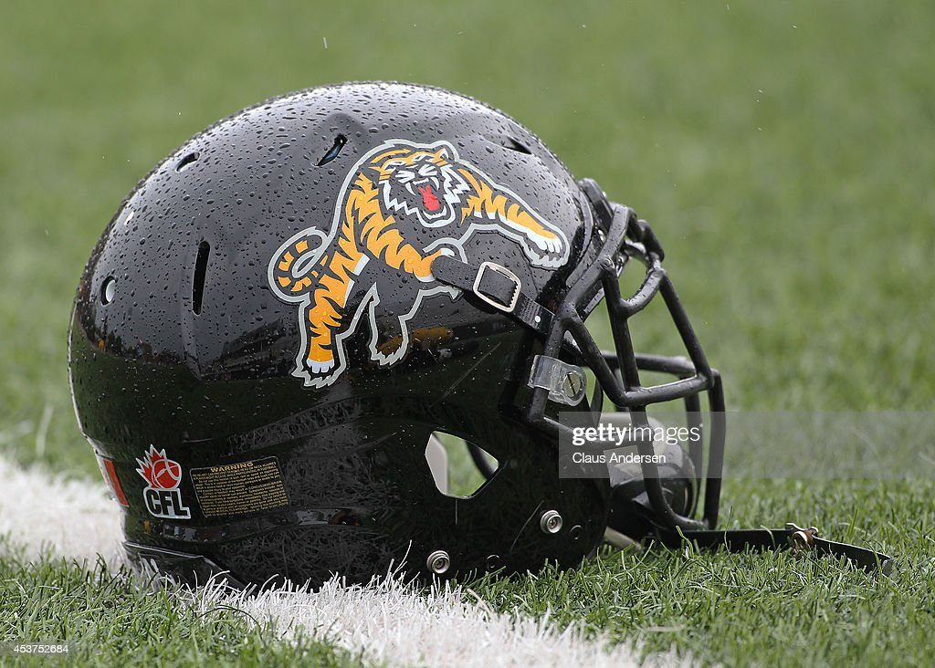 Hamilton TigerCats helmet lies on the field prior to play against the Calgary Stampeders in a CFL game at Ron Joyce Stadium on August 16 2014 in...