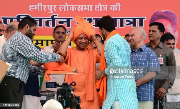 Hamirpur MP Anurag Thakur felicitating Uttar Pradesh Chief Minister Yogi Adityanath during a rally organised at closing of Himachal BJP's Parivartan...