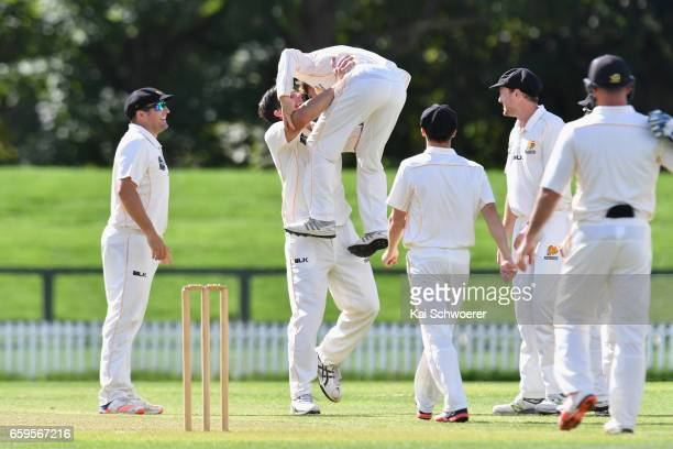 Hamish Bennett of Wellington is congratulated by Hamish Marshall of Wellington after dismissing Peter Fulton of Canterbury during the Plunket Shield...