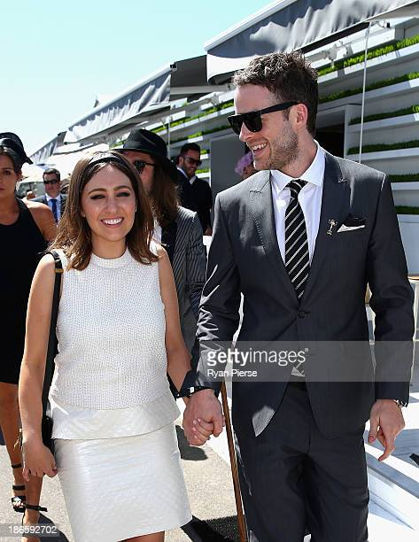 Hamish Blake and Zoe Foster arrive on Victoria Derby Day at Flemington Racecourse on November 2 2013 in Melbourne Australia