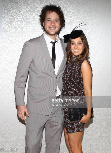 Hamish Blake poses with girlfriend Zoe Foster as they attend BMW Caulfield Cup Day at Caulfield Racecourse on October 16 2010 in Melbourne Australia