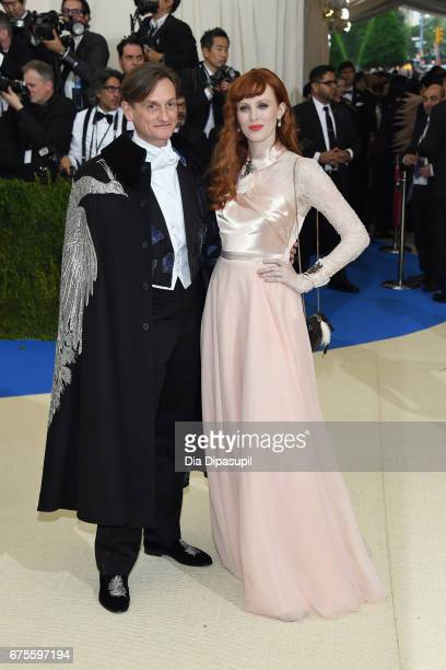 Hamish Bowles and Karen Elson attend the 'Rei Kawakubo/Comme des Garcons Art Of The InBetween' Costume Institute Gala at Metropolitan Museum of Art...
