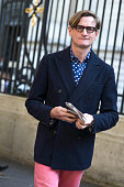 Hamish Bowles wears blue double breasted peak lapel jacket pink trousers and polka dot shirt with Tom Ford glasses after Acne Studios at Hotel...