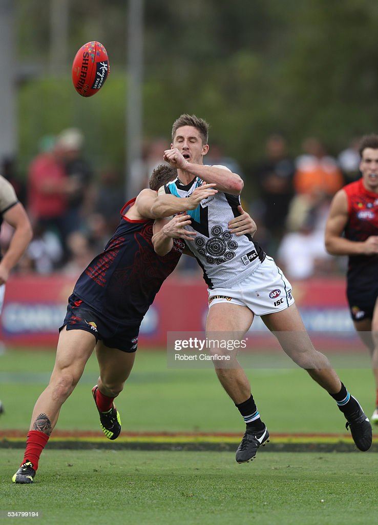 <a gi-track='captionPersonalityLinkClicked' href=/galleries/search?phrase=Hamish+Hartlett&family=editorial&specificpeople=6921726 ng-click='$event.stopPropagation()'>Hamish Hartlett</a> of Port Adelaide gets his handball away as he is tackled by <a gi-track='captionPersonalityLinkClicked' href=/galleries/search?phrase=Dean+Kent&family=editorial&specificpeople=235553 ng-click='$event.stopPropagation()'>Dean Kent</a> of the Demons during the round 10 AFL match between the Melbourne Demons and the Port Adelaide Power at Traeger Park on May 28, 2016 in Alice Springs, Australia.