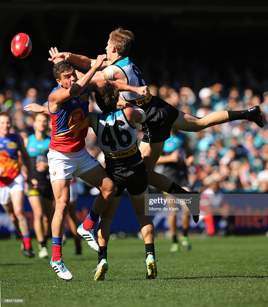 <a gi-track='captionPersonalityLinkClicked' href=/galleries/search?phrase=Hamish+Hartlett&family=editorial&specificpeople=6921726 ng-click='$event.stopPropagation()'>Hamish Hartlett</a> of the Power attempts a high flying mark during the round 4 AFL game between Port Adelaide and the Brisbane Lions at Adelaide Oval on April 12, 2014 in Adelaide, Australia.