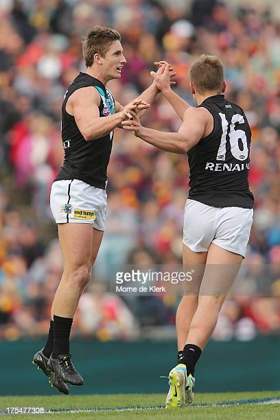 Hamish Hartlett of the Power celebrates after kicking a goal during the round 19 AFL match between the Adelaide Crows and Port Adelaide Power at AAMI...