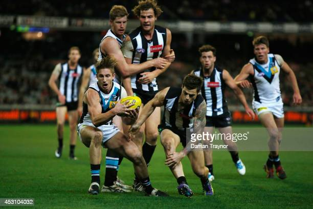 Hamish Hartlett of the Power gathers the ball during the round 19 AFL match between the Collingwood Magpies and the Port Adelaide Power at Melbourne...