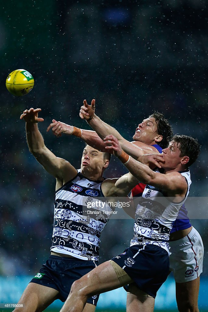 <a gi-track='captionPersonalityLinkClicked' href=/galleries/search?phrase=Hamish+McIntosh&family=editorial&specificpeople=221099 ng-click='$event.stopPropagation()'>Hamish McIntosh</a> and Mark Blicavs of the Cats compete against Will Minson of the Bulldogs during the round 16 AFL match between the Geelong Cats and the Western Bulldogs at Skilled Stadium on July 6, 2014 in Melbourne, Australia.