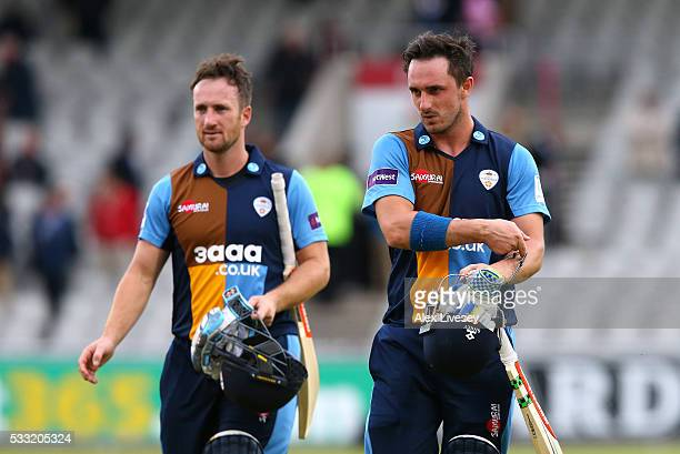 Hamish Rutherford and Neil Broom of Derbyshire leave the pitch after their victory in the NatWest T20 Blast between Lancashire and Derbyshire at Old...