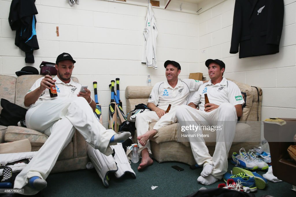 Hamish Rutherford Brendon McCullum and Tim Southee of New Zealand celebrate in the dressing room after winning the Third Test match between New...