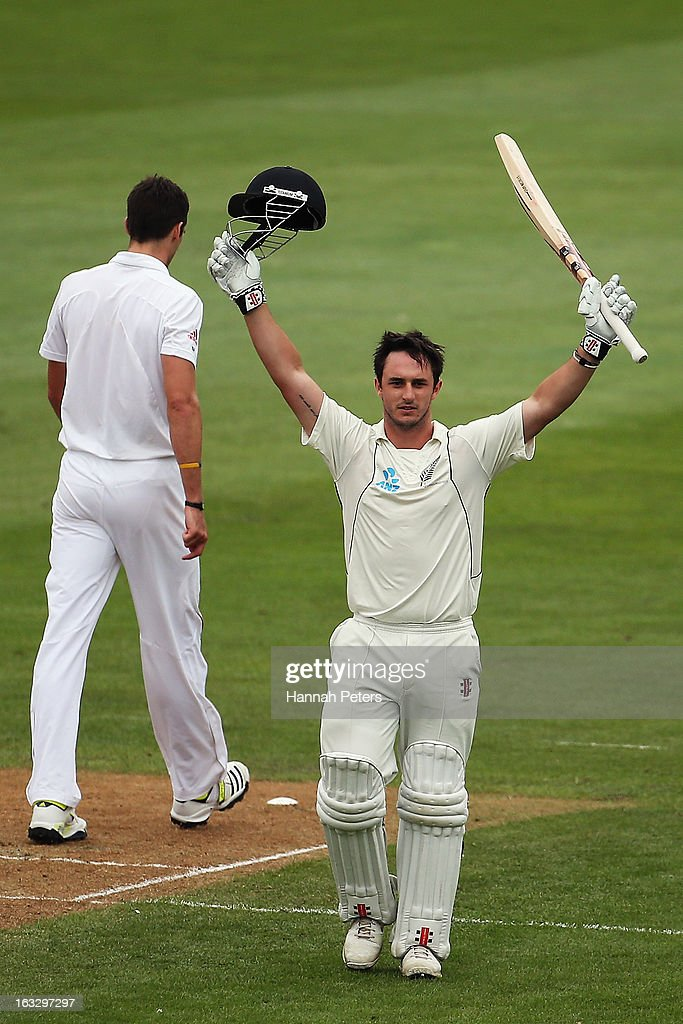 Hamish Rutherford of New Zealand celebrates scoring a century during day three of the First Test match between New Zealand and England at University...