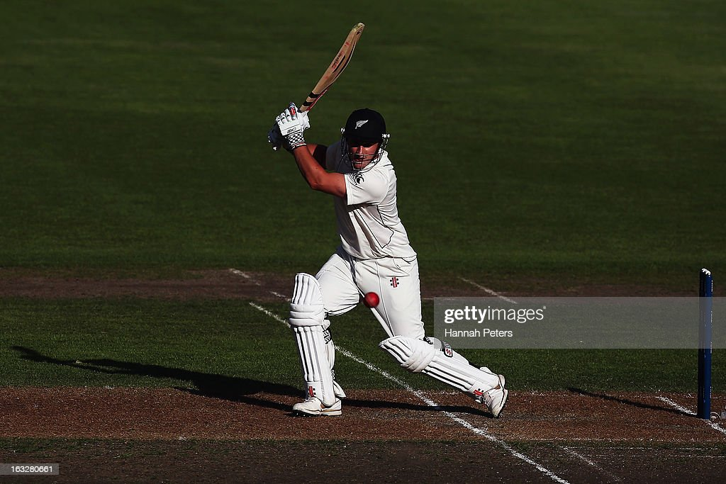 Hamish Rutherford of New Zealand cuts the ball away for four runs during day two of the First Test match between New Zealand and England at...
