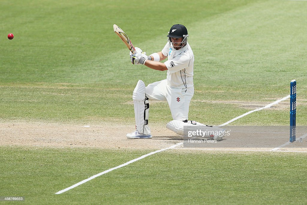 Hamish Rutherford of New Zealand drives the ball away for four runs during day four of the Third Test match between New Zealand and the West Indies...