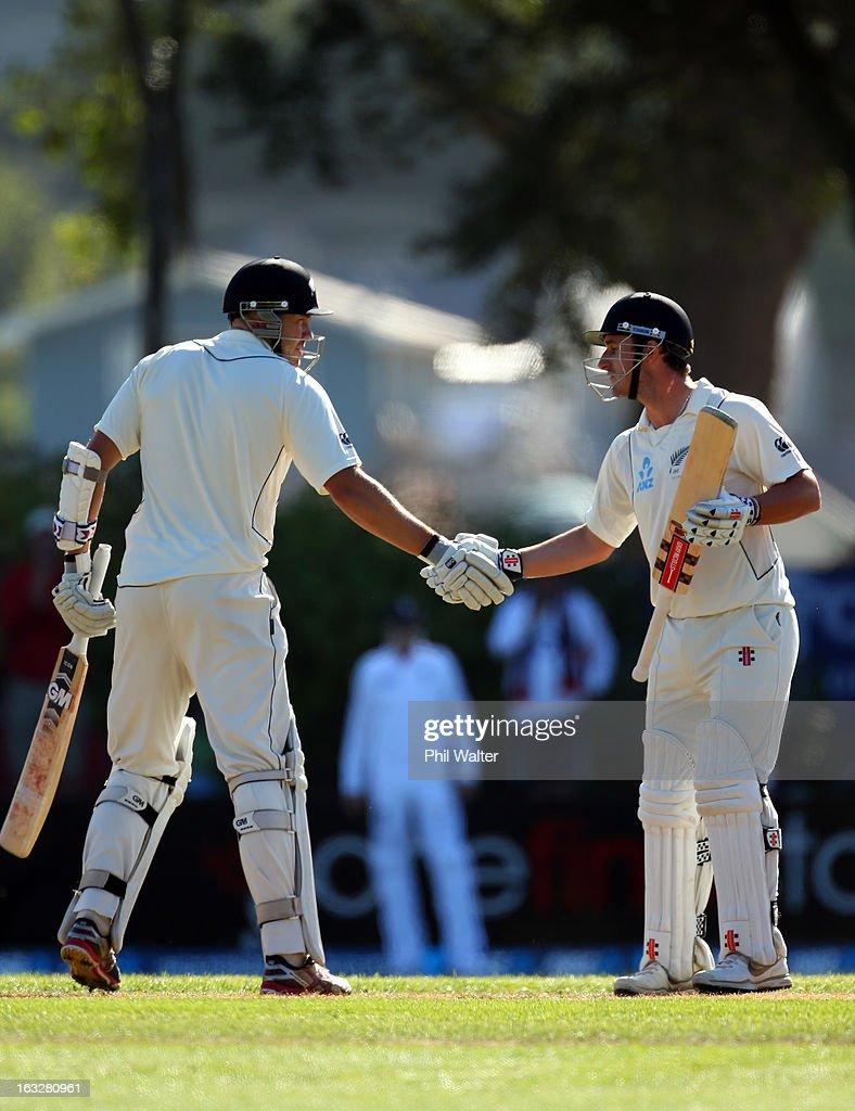 Hamish Rutherford of New Zealand (R) shakes hands with Peter Fulton (L) after making 50 runs on day two of the First Test match between New Zealand and England at University Oval on March 7, 2013 in Dunedin, New Zealand.