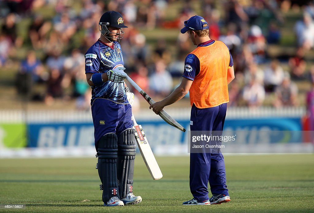 Hamish Rutherford of Otago has his bat replaced after hitting a six during the HRV Final match between the Otago Volts and Northern Districts at...