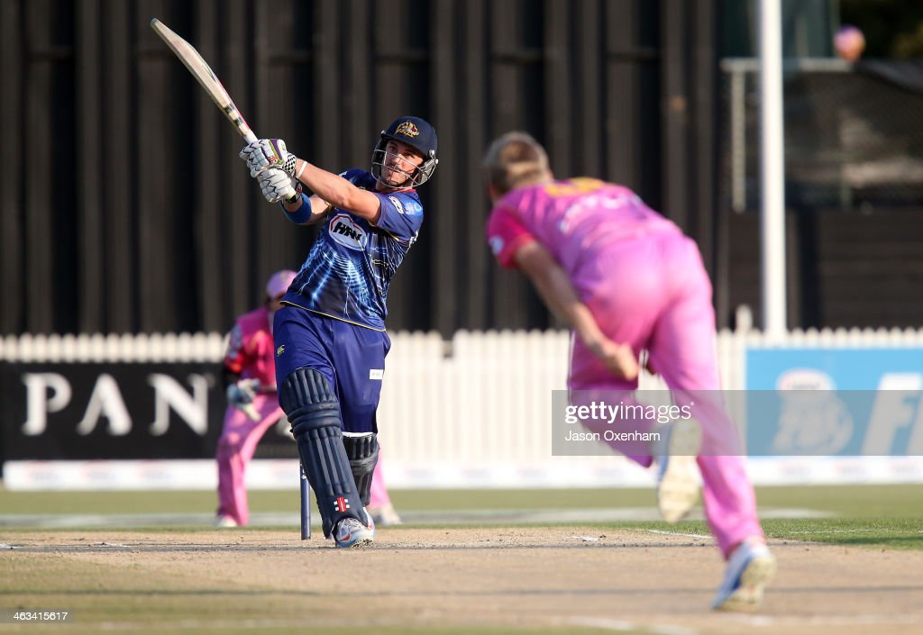 Hamish Rutherford of Otago hits Scott Kuggeleijn of Northern Districts out of the park during the HRV Final match between the Otago Volts and...