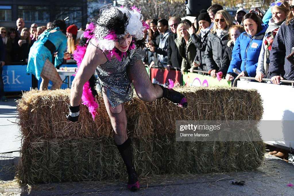 Hamish Samll jumps the hay bale during the Downtown Day Drag race at the Queenstown Winter Festival on June 29, 2016 in Queenstown, New Zealand.