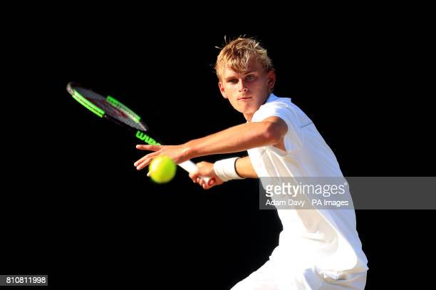 Hamish Stewart in action in the Boys Singles on day six of the Wimbledon Championships at The All England Lawn Tennis and Croquet Club Wimbledon