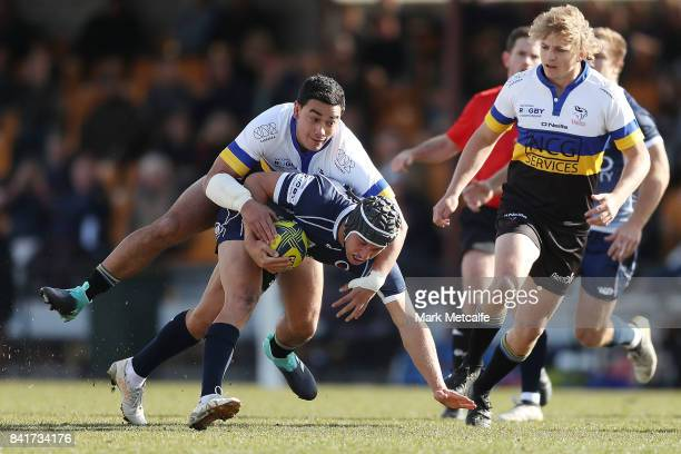 Hamish Stewart of Queensland Country is tackled by Wharenui Hawera of the Vikings during the round one NRC match between Canberra and Queensland...