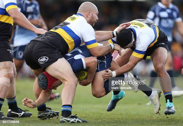 Hamish Stewart of Queensland Country is tackled during the round one NRC match between Canberra and Queensland Country at Viking Park on September 2...