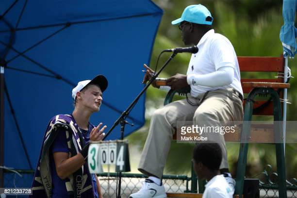 Hamish Stewart of Scotland shows his frustration to the chair umpire between games as he competes in the Boy's Singles gold medal tennis match...