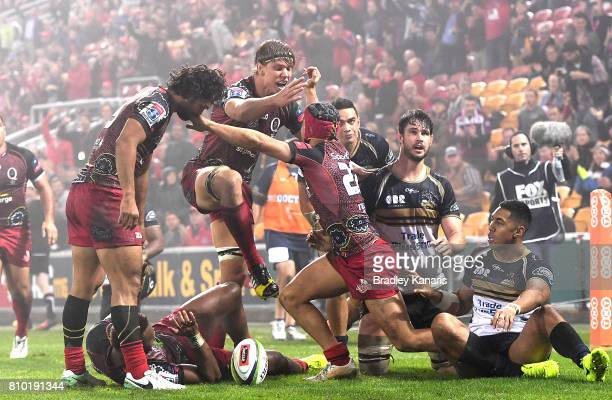 Hamish Stewart of the Reds is congratulated by team mates after scoring a try during the round 16 Super Rugby match between the Reds and the Brumbies...
