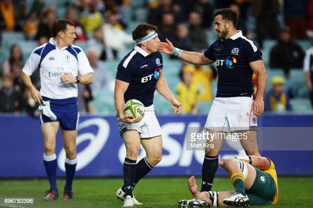 Hamish Watson of Scotland celebrates with Alex Dunbar of Scotland after scoring a try during the International Test match between the Australian...